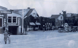 The Birnschein Garage and gas station, later Mueller Bros. Bertschinger Lumber Yard is to the left.